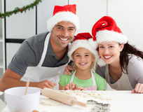 Happy family preparing Christmas cookies Royalty Free Stock Images