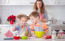 Happy family preparing cookies for Christmas eve Royalty Free Stock Photos