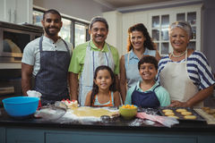Happy family preparing dessert in kitchen Royalty Free Stock Photography
