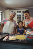 Happy family preparing desserts in kitchen Royalty Free Stock Images