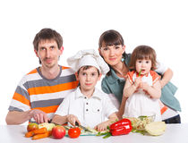 Happy Family Preparing Dinner Together Stock Images