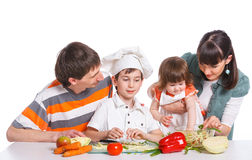 Happy Family Preparing Dinner Together Stock Photo