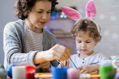Happy Family Preparing for Easter Royalty Free Stock Photography