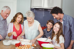 Happy family preparing food Royalty Free Stock Image
