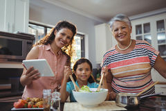Happy family preparing food in kitchen Royalty Free Stock Images