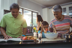 Happy family preparing food in kitchen Stock Photography