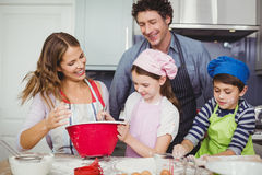 Happy family preparing food in kitchen. Smiling happy family cooking food in kitchen at home Stock Photography