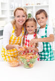 Happy family preparing fresh salad Stock Photography