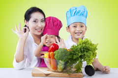 Happy family preparing healthy food Royalty Free Stock Photo