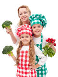 Happy family preparing healthy vegetables meal Royalty Free Stock Photos