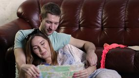 Happy family preparing for journey and reading map stock footage