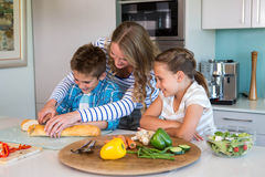 Happy family preparing lunch together Royalty Free Stock Image