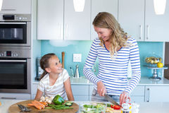 Happy family preparing lunch together Stock Image