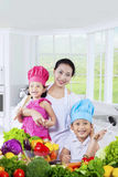 Happy family preparing a meal Stock Photography