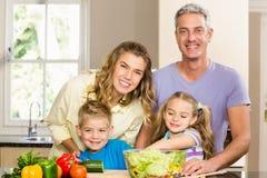 Happy family preparing salad Royalty Free Stock Image