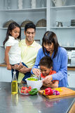 Happy family preparing salad in the kitchen Royalty Free Stock Images