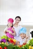 Happy family preparing a salad Royalty Free Stock Photos