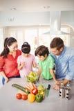 Happy family preparing salad Stock Photos