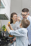 Happy family preparing spaghetti in kitchen Royalty Free Stock Photo