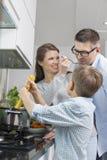 Happy family preparing spaghetti in kitchen Royalty Free Stock Photo