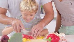 Happy family preparing vegetables Stock Photos
