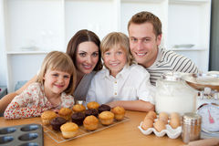 Happy family presenting their muffins Stock Image