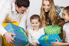 Happy family with presents Stock Photo