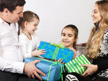 Happy family with presents Royalty Free Stock Photo