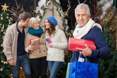 Happy Family With Presents At Christmas Store Royalty Free Stock Images