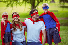 Happy family pretending to be superhero. In the park Royalty Free Stock Photo