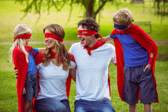 Happy family pretending to be superhero Royalty Free Stock Images