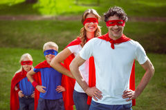 Happy family pretending to be superhero. In the park Stock Photo