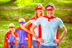 Happy family pretending to be superhero Royalty Free Stock Photography