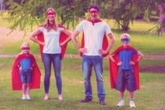 Happy family pretending to be superhero Stock Photo