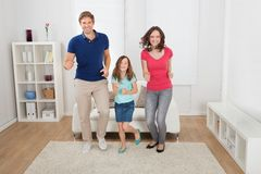 Happy family pretending to run Stock Photo