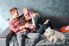 Happy family with puppie royalty free stock photos