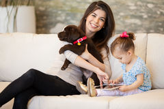 Happy family with a puppy Stock Image