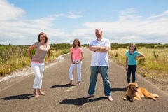A happy family on a quiet country road Stock Photos