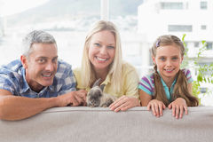 Happy family with rabbit on sofa at home Royalty Free Stock Images