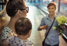 Happy family on a rail station Stock Photos