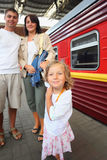 Happy family at railway station, focus on daughter Stock Images