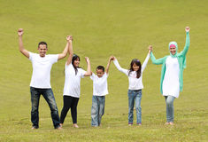 Happy family raise hand together Royalty Free Stock Image