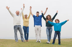 Happy family raised their hands Royalty Free Stock Photography