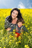 Happy family in rapeseed field Royalty Free Stock Image