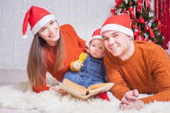 Happy family reading a book with christmas fairy tale Royalty Free Stock Image
