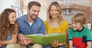 Happy family reading book stock video