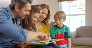 Happy family reading book stock footage