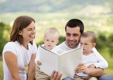 Happy family is reading book Royalty Free Stock Image