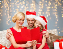 Happy family reading christmas postcard Royalty Free Stock Photo