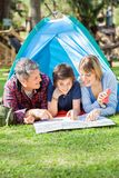 Happy Family Reading Map In Tent Stock Photos